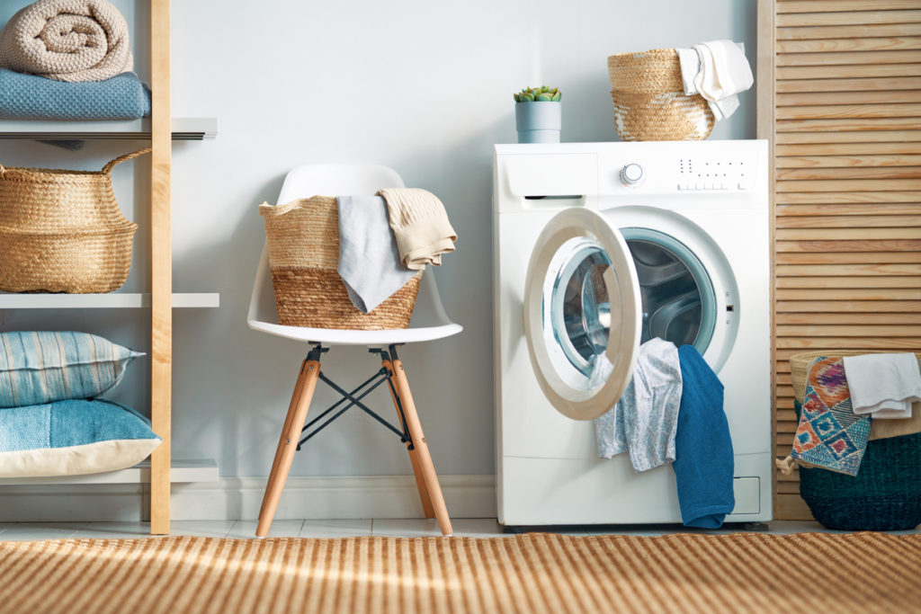 Interior of a real laundry room with a washing machine at home   Shark vacuums   how to clean washing machine tips