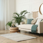 4 Health Benefits of Cleaner Air | an open living room with house plants and a mirror | shark vacuum shark air purifier